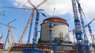 FANGCHENG, CHINA - MAY 23:  The dome is hoisted onto the reactor building at the construction site of the Fangchenggang Nuclear Power Plant Unit 3 on May 23, 2018 in Fangcheng, China. The nuclear reactor will be put into service in 2022.  (Photo by VCG/VCG via Getty Images)