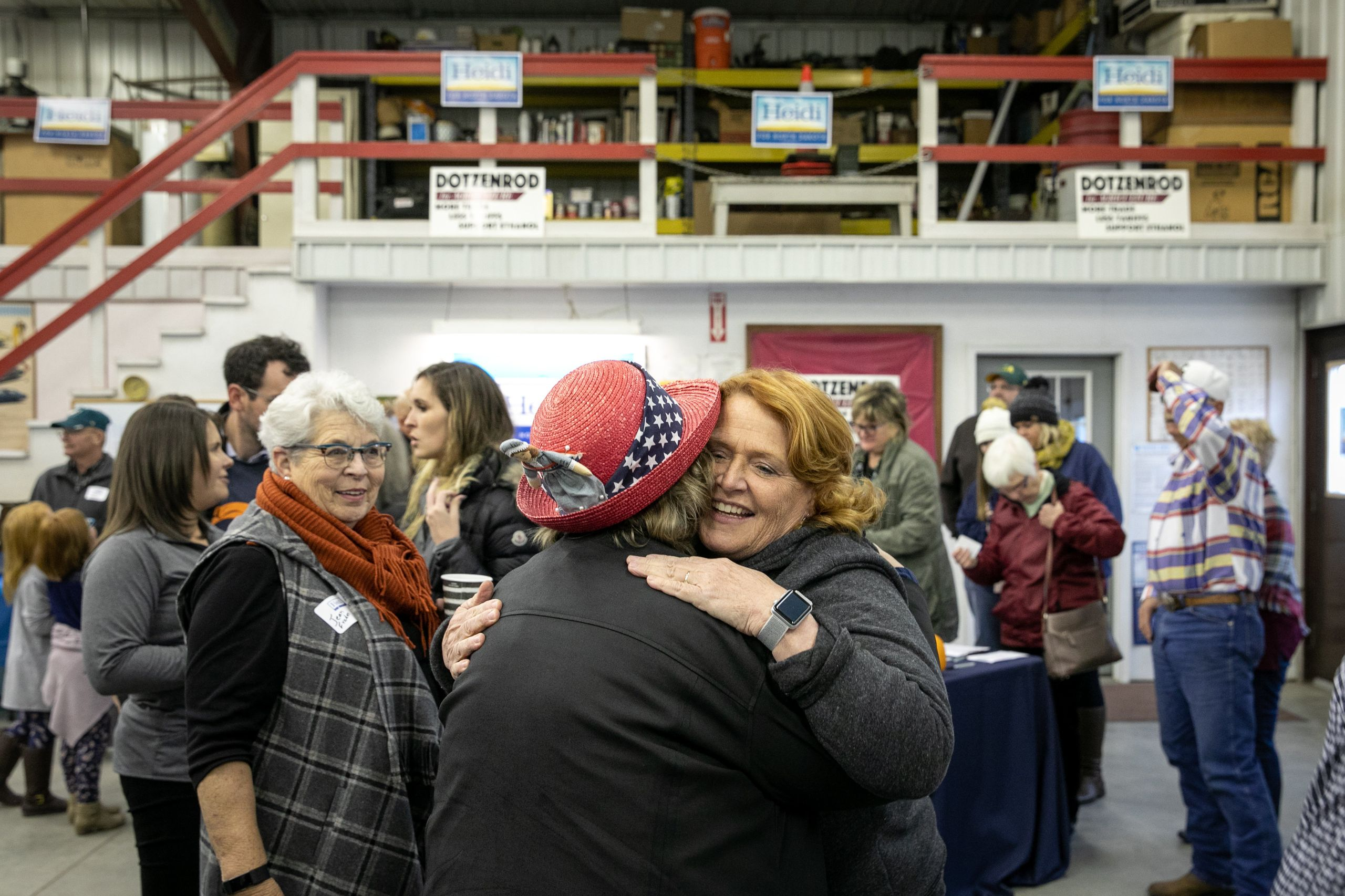 Heitkamp hugs a backer at the rally in Wyndmere.