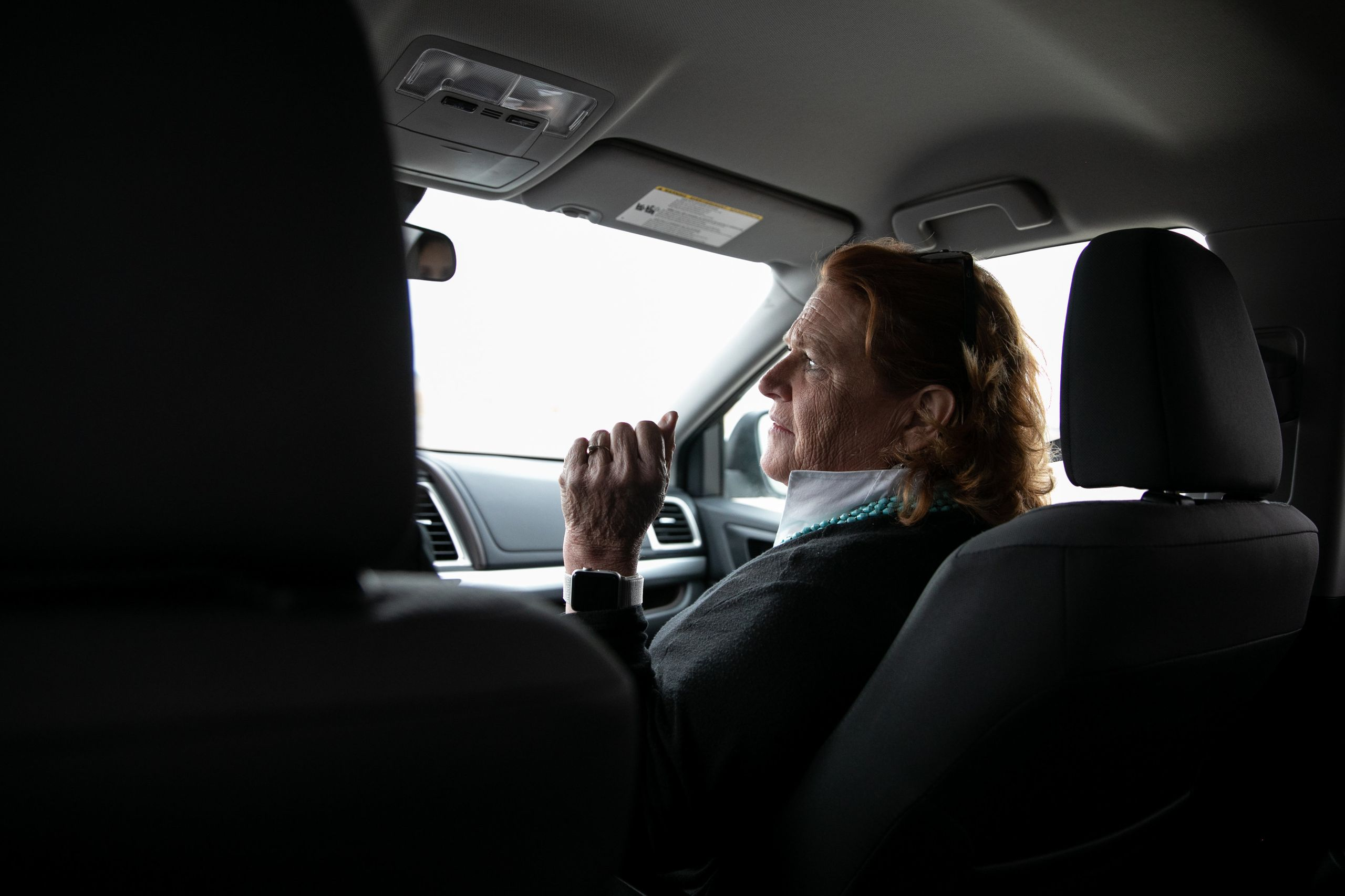 Heitkamp rides in a car with campaign staff to a campaign event on the Turtle Mountain Reservation on Monday.