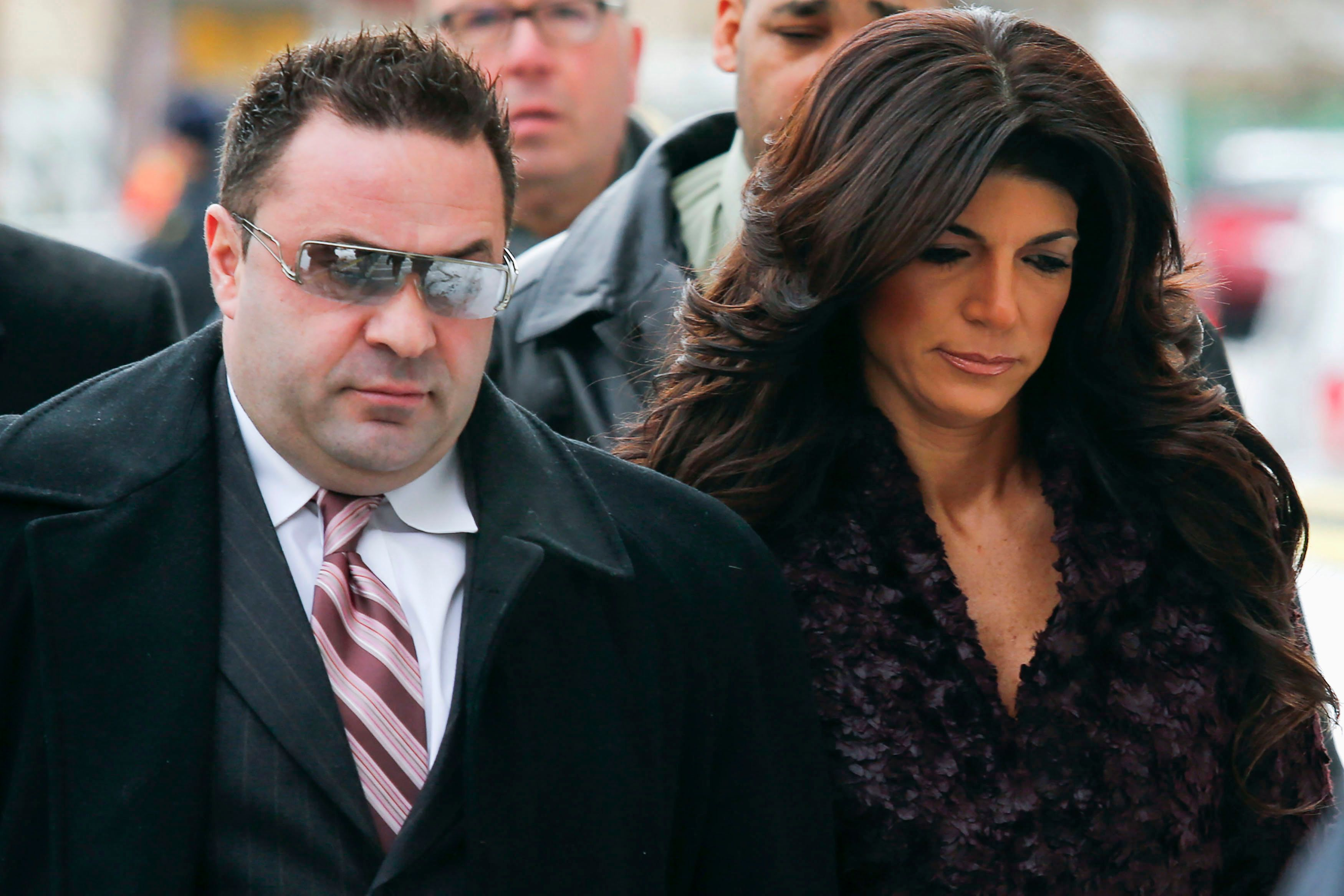 """Teresa Giudice, 41, (R) and her husband Giuseppe """"Joe"""" Giudice, 43, (L) arrive at the Federal Court in Newark, New Jersey, March 4, 2014. """"Real Housewives of New Jersey"""" cast members Teresa and Giuseppe are expected to plead guilty to charges stemming from their loan fraud case in which prosecutors say they lied on financial applications and hid income. REUTERS/Eduardo Munoz (UNITED STATES - Tags: CRIME LAW ENTERTAINMENT)"""