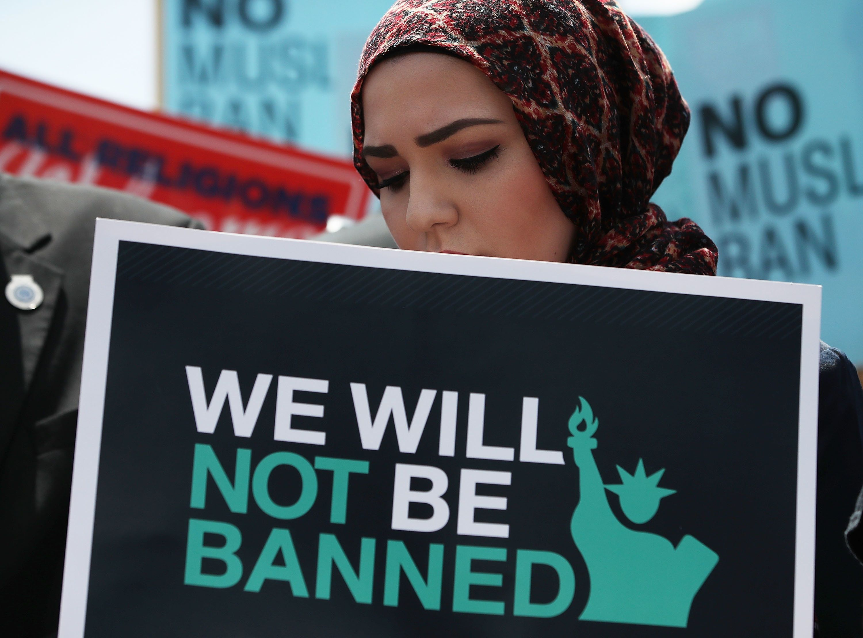 WASHINGTON, DC - JUNE 26: A women participates in demonstration against U.S. President Trump's travel ban as protesters gather outside the U.S. Supreme Court following a court issued immigration ruling June 26, 2018 in Washington, DC. The court issued a 5-4 ruling upholding U.S. President Donald Trump's travel ban imposing limits on travel from several primarily Muslim nations. (Photo by Mark Wilson/Getty Images)