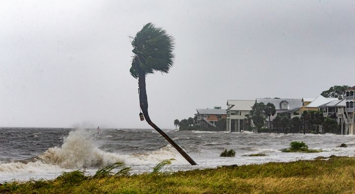 The storm surge and waves from Hurricane Michael batter homes in Shell Point Beach, Florida, Oct. 10.