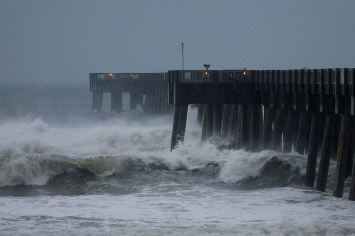 Waves crash along a pier as Hurricane Michael approaches Panama City Beach, Florida, on Oct. 10.