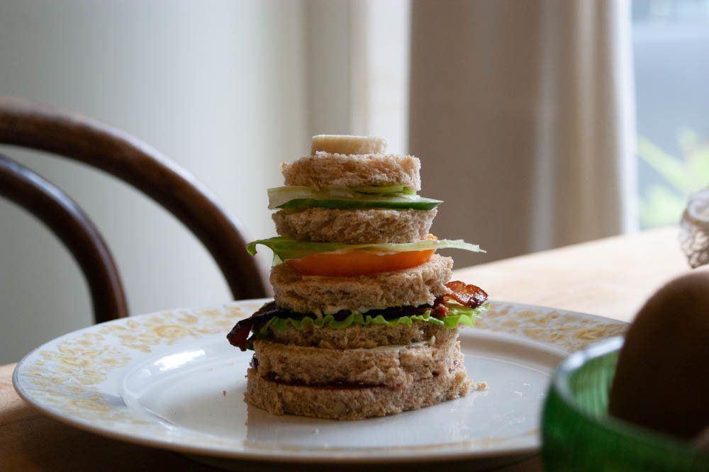 Yes, there's a slice of banana on top of that sandwich.
