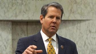 "FILE PHOTO:  Georgia Secretary of State Brian Kemp speaks with visitors to the state capitol about the ""SEC primary"" involving a group of southern states voting next month in Atlanta, Georgia, U.S., February 24, 2016.  REUTERS/Letitia Stein/File Photo"