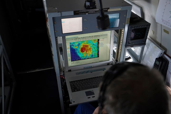 Flight director and NOAA meteorologist Richard Henning looks at a satellite view of Hurricane Michael from his workstation ab