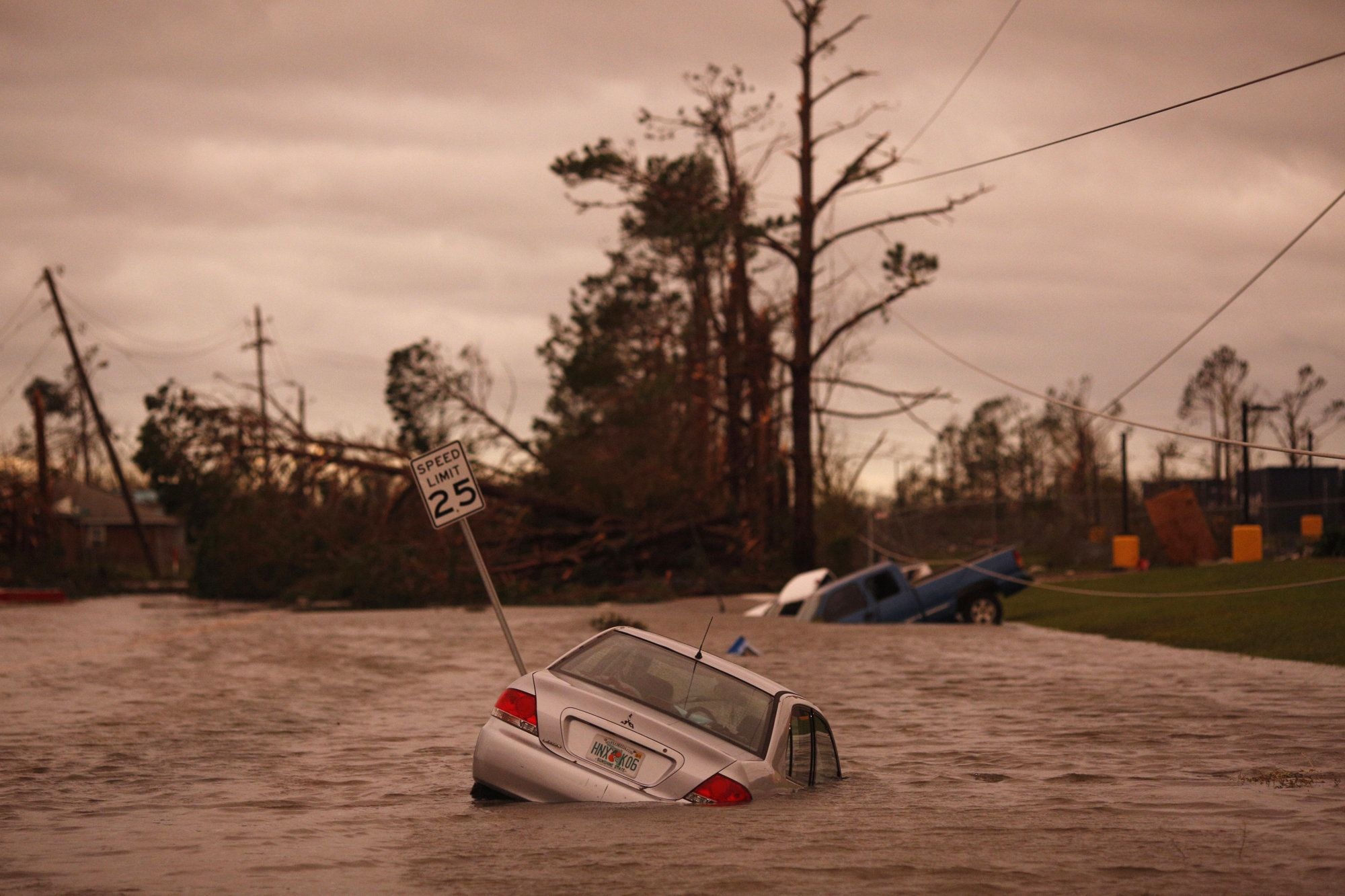 Vehicles sit partially submerged in floodwaters after Hurricane Michael hit in Panama City, Florida, U.S., on Wednesday, Oct. 10, 2018. Hurricane Michael became the strongest storm to hit the U.S. mainland since 1992, and one of the four most intense in history, with winds that reached 155 miles per hour as it made landfall in Florida. Photographer: Luke Sharrett/Bloomberg via Getty Images