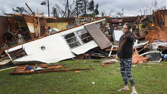 PANAMA CITY, FL - OCTOBER 10:  Haley Nelson stands in front of what is left of one of her fathers trailer homes after hurricane Michael passed through the area on October 10, 2018 in Panama City, Florida. The hurricane hit the Florida Panhandle as a category 4 storm.  (Photo by Joe Raedle/Getty Images)