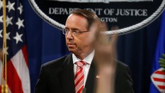 Deputy U.S. Attorney General Rod Rosenstein takes questions after announcing grand jury indictments of 12 Russian intelligence officers in special counsel Robert Mueller's Russia investigation, during a news conference at the Justice Department in Washington, U.S., July 13, 2018. REUTERS/Leah Millis