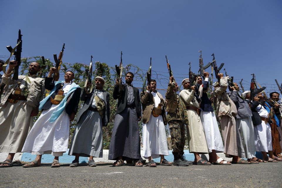 Tribal gunmen loyal to the Huthi movement brandish their weapons during a gathering in Sanaa to show...