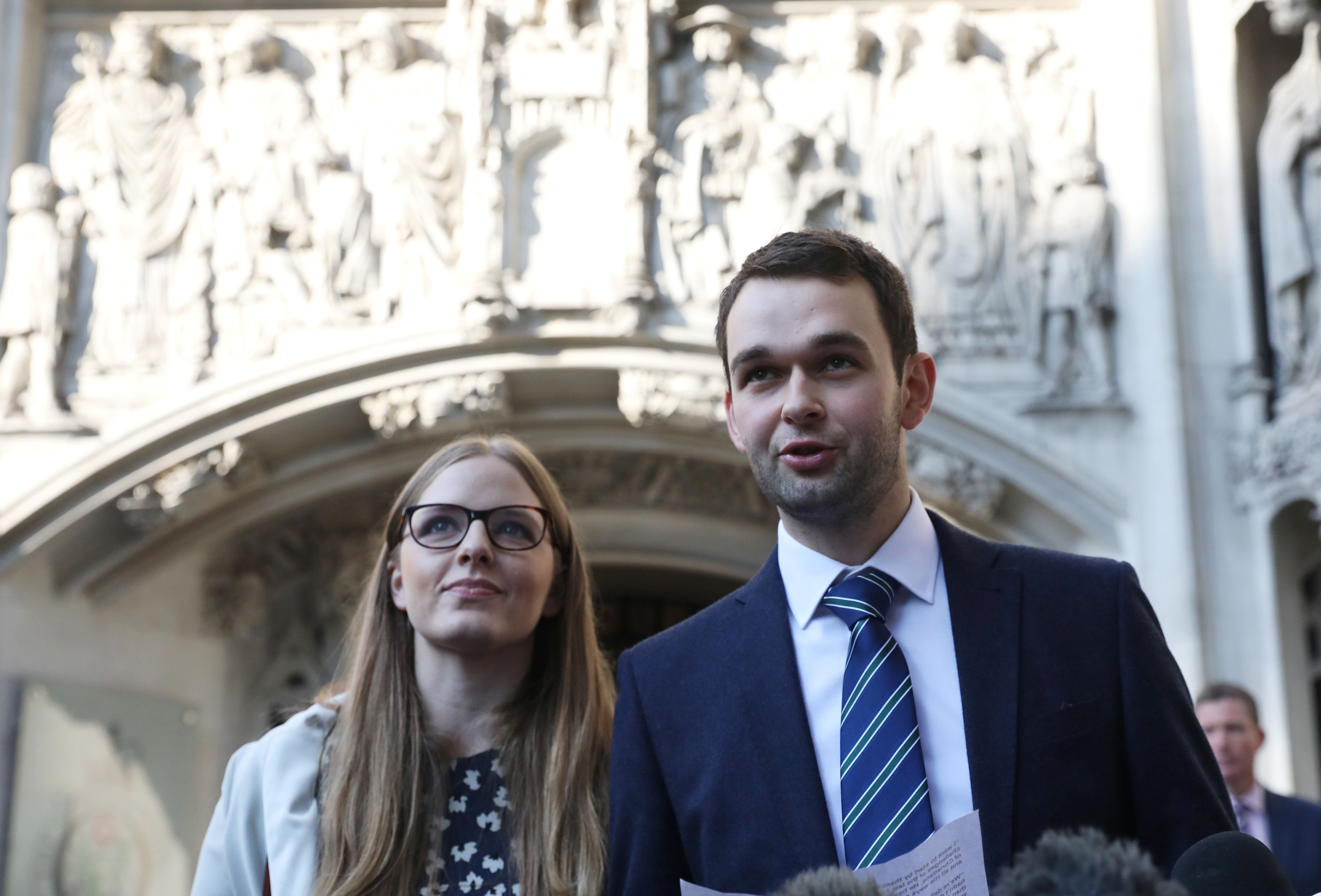 Daniel and Amy McArthur, who own Ashers Bakery in Belfast, speak as they leave the Supreme Court in London on Oct. 10.