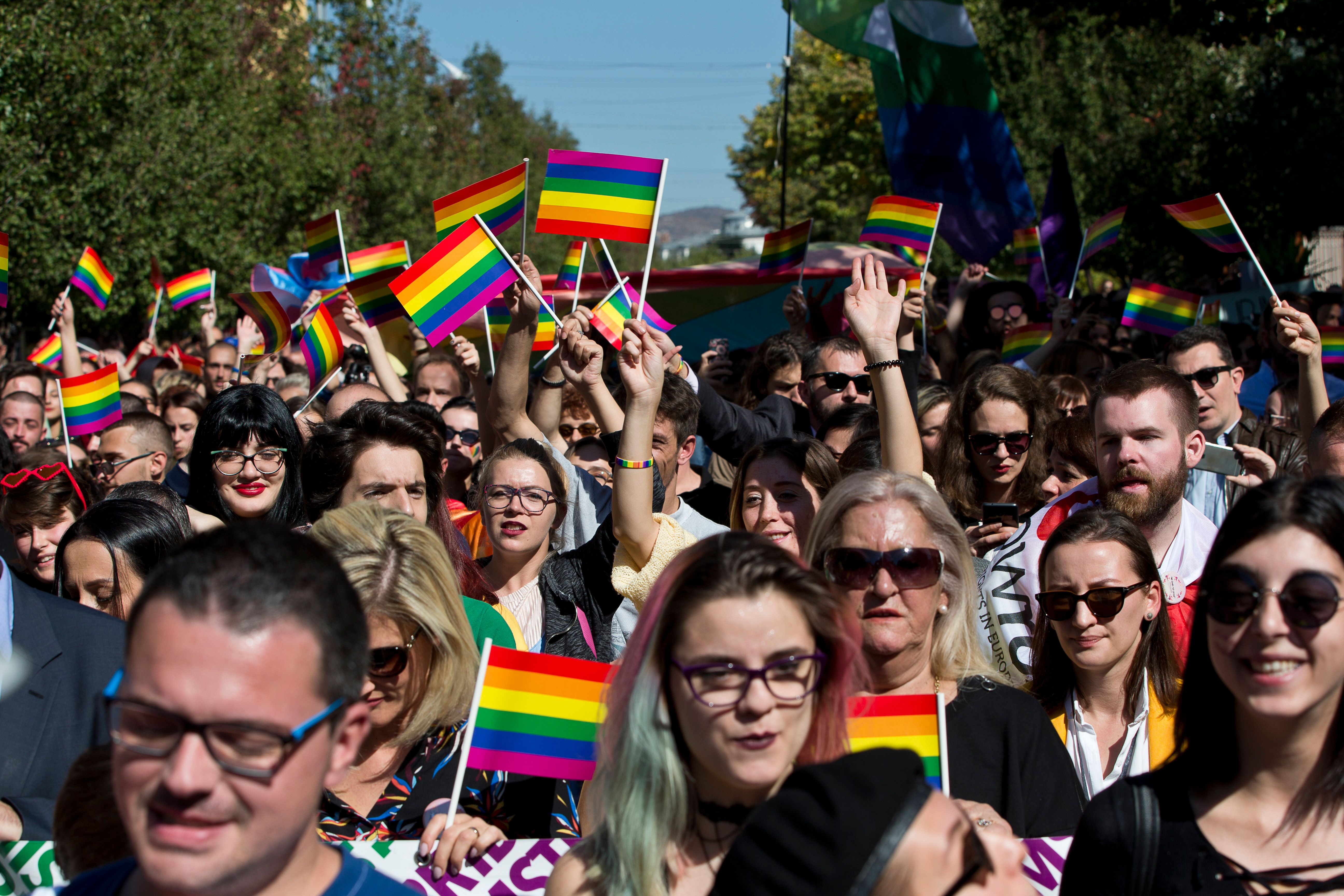 People participate in the pride parade in the Kosovo capital Pristina on Wednesday, Oct. 10, 2018. Hundreds of people in Kosovo have held a gay pride parade for the second straight year in the capital. The gay community has asked for more freedom of expression and non-discrimination, calling on society to be more tolerant and accept diversity. (AP Photo/Visar Kryeziu)