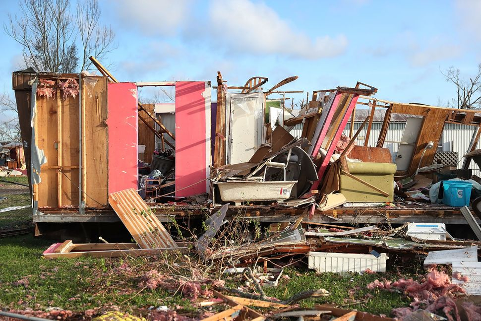 Debris is strewn next to a mobile home destroyed by Hurricane Michael.