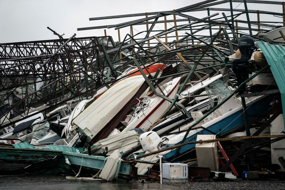 A warehouse of boats is seen damaged at Treasure Island Marina in Panama City.