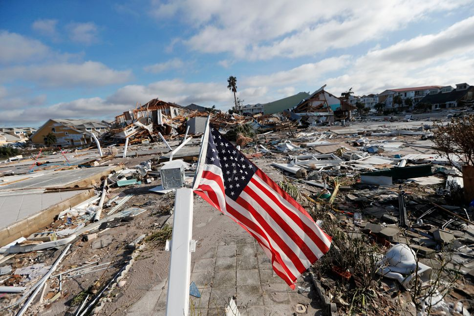 An American flag flies amidst destruction in Mexico Beach.