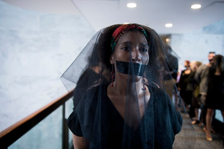 A group of women wear black veils and black tape over their mouths outside of the fourth day of Brett Kavanaugh's hearing before members of the Senate Judiciary Committee on Sept. 7, 2018.