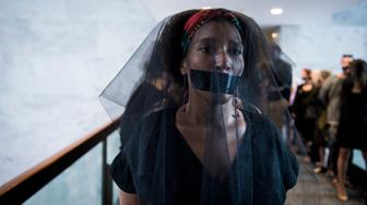 UNITED STATES - SEPT 7: A group of women are seen wearing black veils and black tape over their mouths outside of the fourth day of Brett Kavanaugh's hearing before members of the Senate Judiciary Committee in the Hart Senate Office Building Friday Sept. 7, 2018. (Photo By Sarah Silbiger/CQ Roll Call)