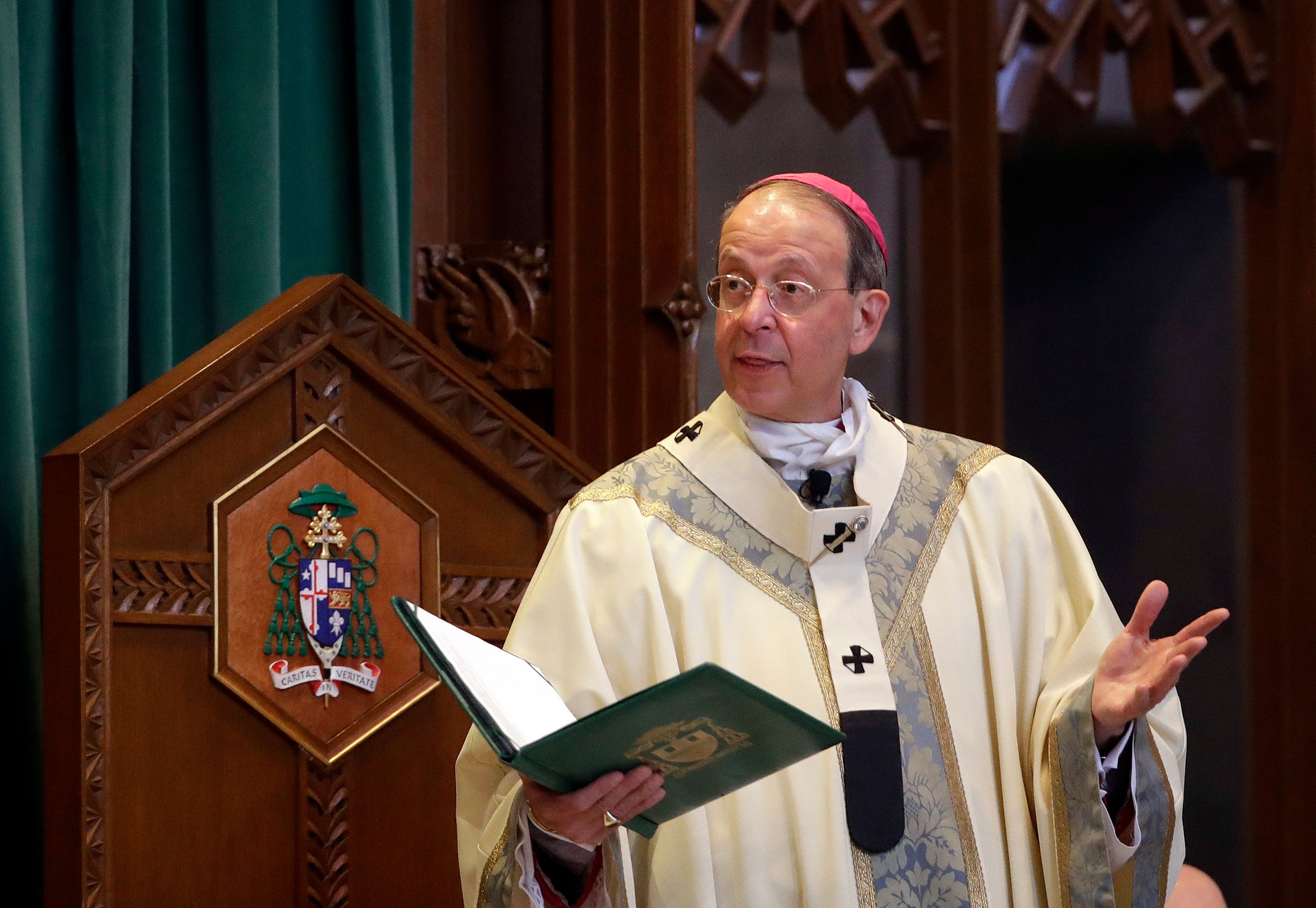 Baltimore Archbishop William Lori leads a funeral Mass for Cardinal William Keeler at the Cathedral of Mary Our Queen in Baltimore, Tuesday, March 28, 2017. (AP Photo/Patrick Semansky)