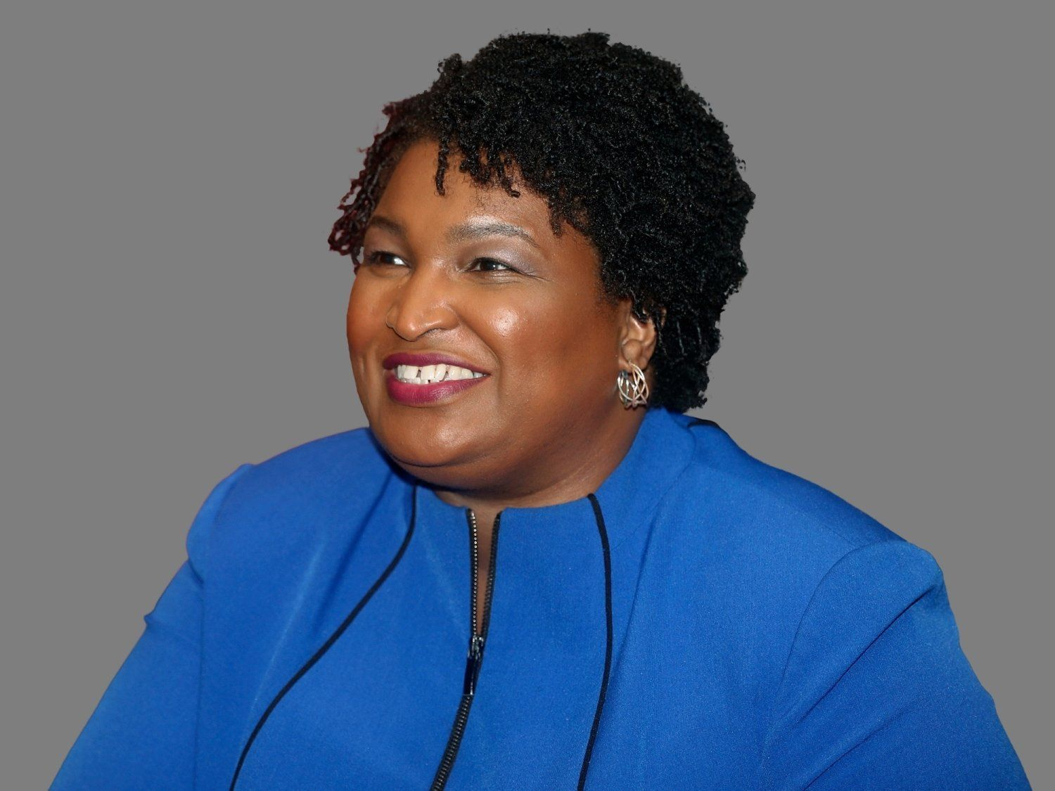 Stacey Abrams headshot, as Georgia Democratic gubernatorial candidate, graphic element on gray