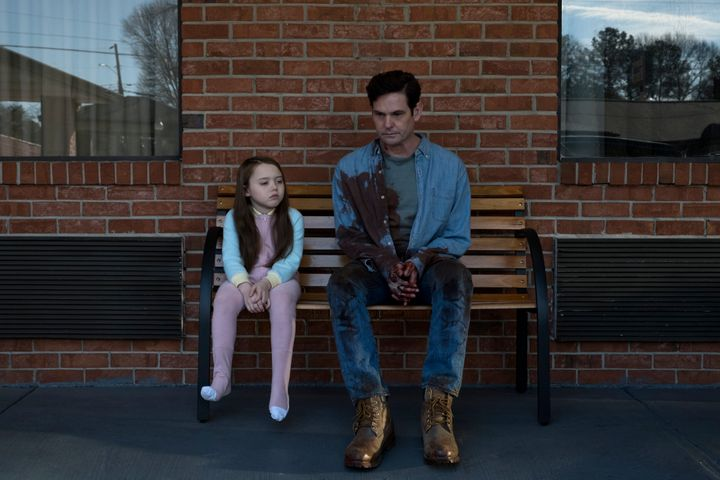 "Henry Thomas and Violet McGraw in Netflix's ""The Haunting of Hill House."""