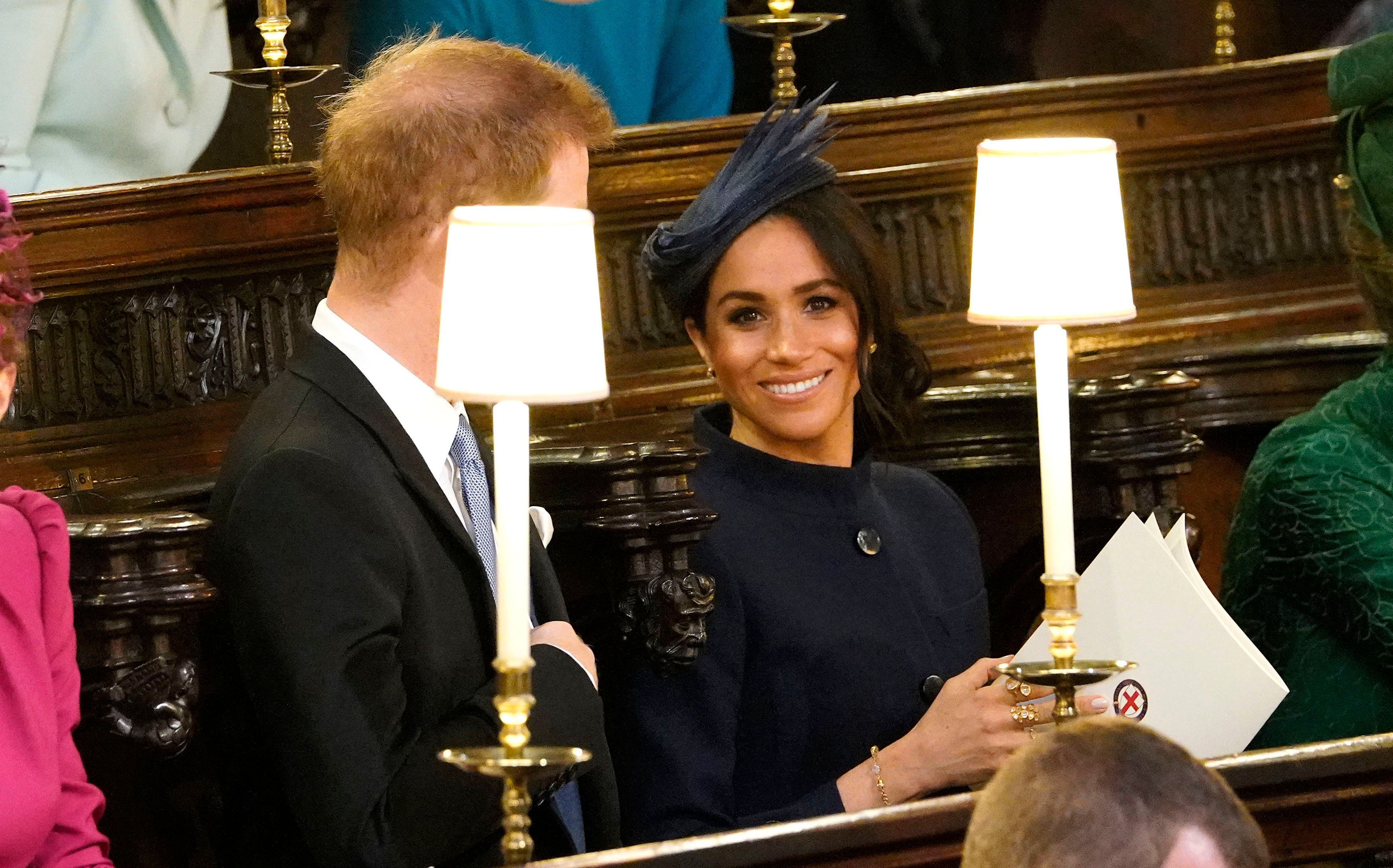 The Duke and Duchess of Sussex take their seats ahead of the wedding of Princess Eugenie to Jack Brooksbank at St George's Chapel in Windsor Castle.