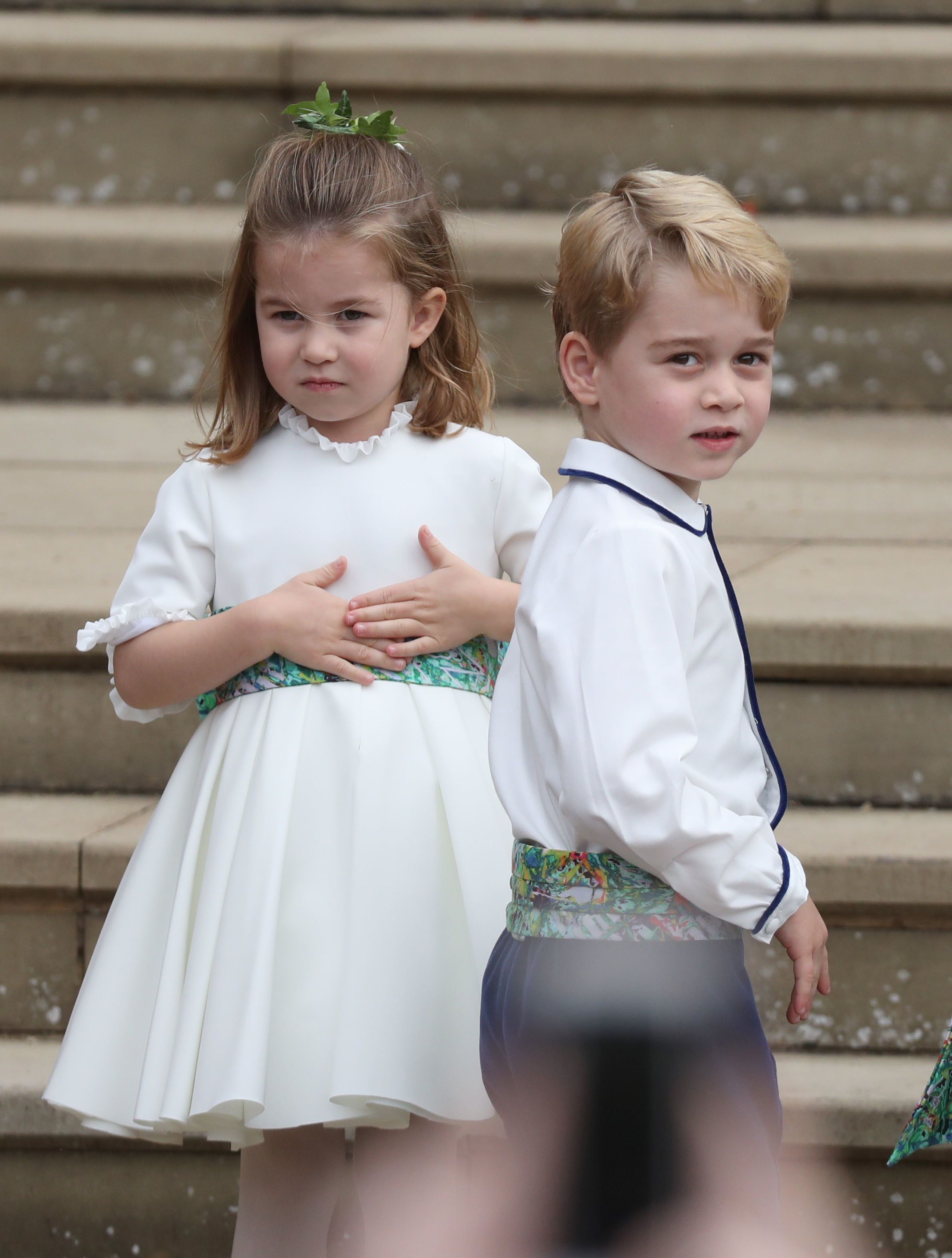 Princess Charlotte and Prince George arrive for the wedding of Princess Eugenie to Jack Brooksbank at St George's Chapel in Windsor Castle.