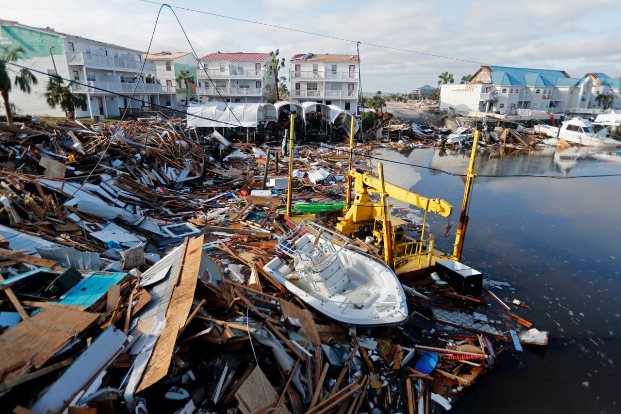 A boat sits amidst debris in the aftermath of Hurricane Michael in Mexico Beach, Fla.