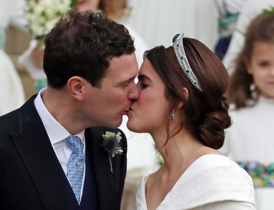 Princess Eugenie and Jack Brooksbank kiss on the steps of St. George's Chapel.