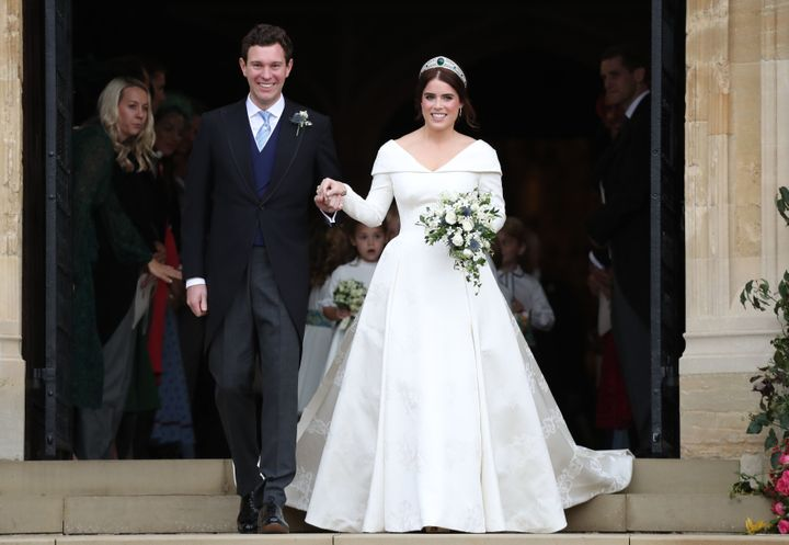 Princess Eugenie of York and Jack Brooksbank leave the St. George's Chapel at Windsor Castle after tying the knot on Friday.