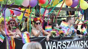 People take part in the Gay Pride parade in Warsaw, Poland, Saturday, June 9, 2018. The pride celebrations come as LGBT activists say a conservative turn in Poland is only motivating them to fight harder for their rights, even though their hopes of seeing same-sex marriage legalized has no chance now in the country. (AP Photo/Czarek Sokolowski)