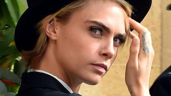 Cara Delevingne after the wedding of Princess Eugenie to Jack Brooksbank at St George's Chapel in Windsor Castle, Windsor, Britain, October 12, 2018. Matt Crossick/Pool via REUTERS