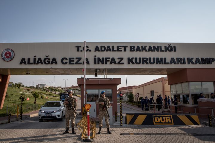 Turkish soldiers stand guard outside the entrance to Aliaga Prison Court after American pastor Andrew Brunson arrived ahead o