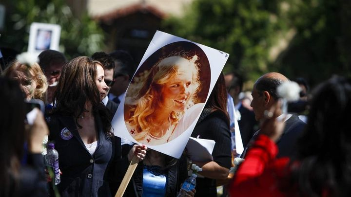 <p>A woman holds a photo of Marsy Nicholas, whom Marsy's Law was named for, during a 2013 victims' rights march and rally in Santa Ana, California. In 2008, California became the first of six states to add a Marsy's Law victims' rights amendment to its constitution. </p>