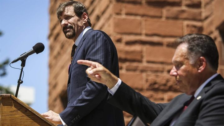 Henry Nicholas speaks, as Orange County District Attorney Tony Rackauckas gestures next to him during a 2013 victims' rights
