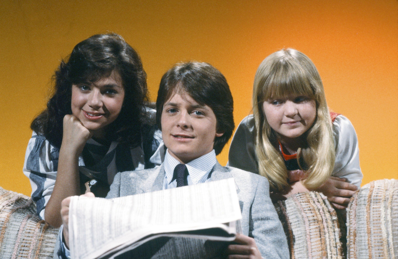 FAMILY TIES -- Season 1 -- Pictured: (l-r) Justine Bateman as Mallory Keaton, Michael J. Fox as Alex P. Keaton, Tina Yothers as Jennifer Keaton-- Photo by: Paul Drinkwater/NBC/NBCU Photo Bank