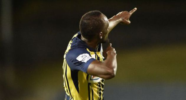 Usain Bolt Strikes His Signature Pose Celebrating First Goals In Pro