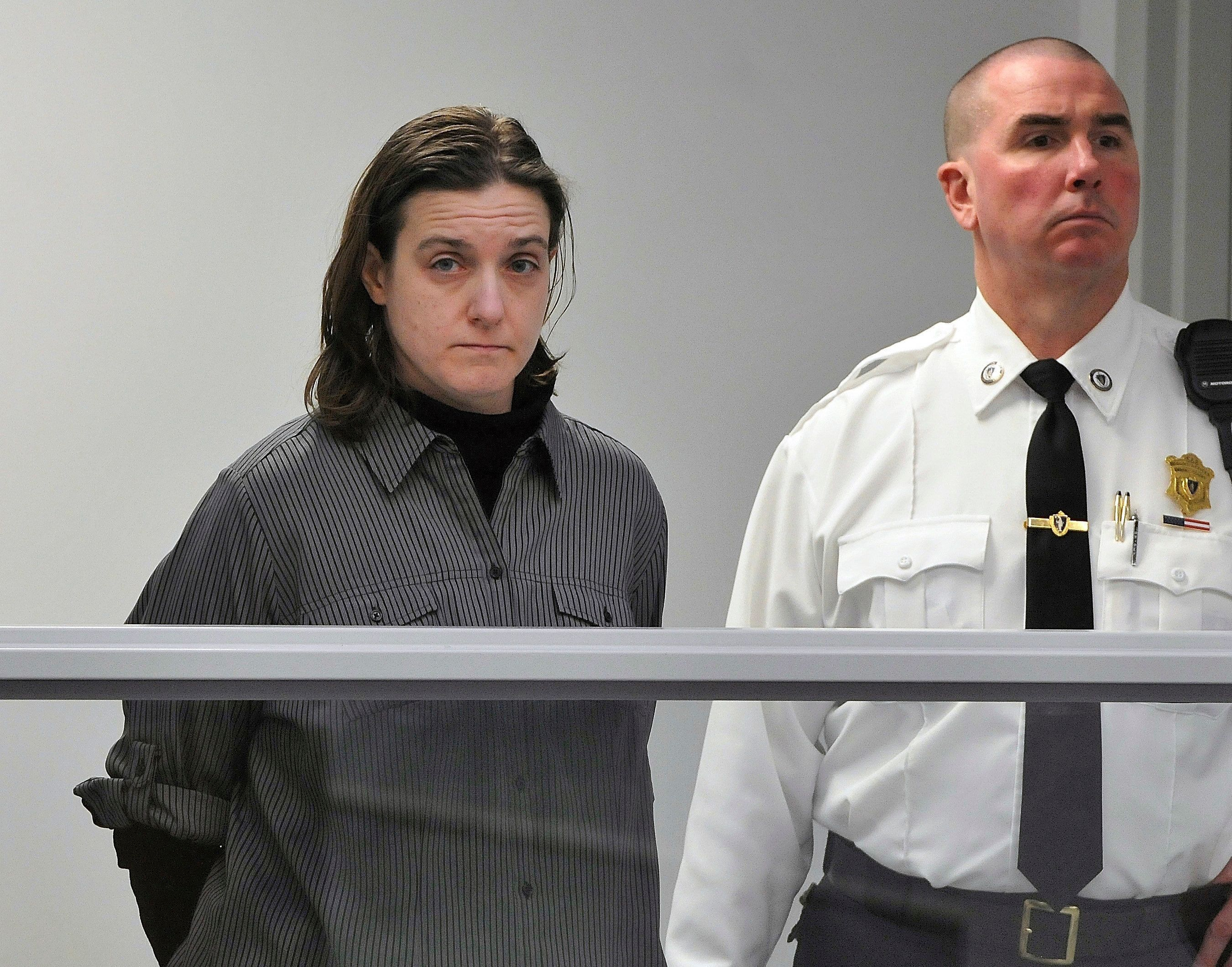 FILE - In this Jan. 22, 2013, file photo, Sonja Farak, left, stands during her arraignment at Eastern Hampshire District Court in Belchertown, Mass. The Massachusetts Supreme Judicial Court will hear arguments on Tuesday, May 8, 2018, that thousands more cases be thrown out which were potentially tainted by misconduct of former chemist Farak. Authorities have said Farak was high almost every day she worked at a state drug lab for eight years. (Don Treeger/The Republican via AP, Pool, File)