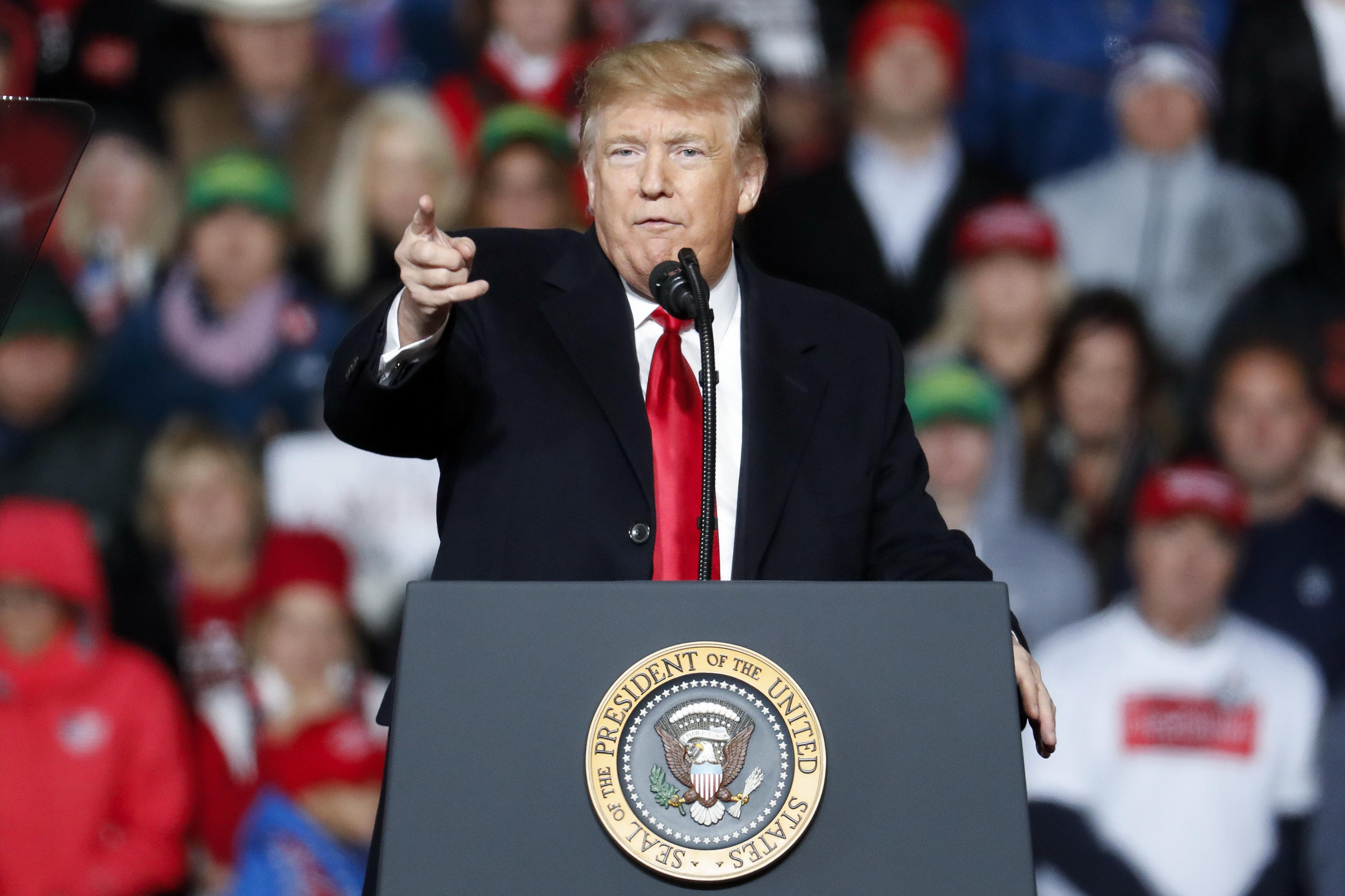 President Donald Trump speaks at a rally endorsing the Republican ticket, Friday, Oct. 12, 2018, in Lebanon, Ohio. (AP Photo/John Minchillo)
