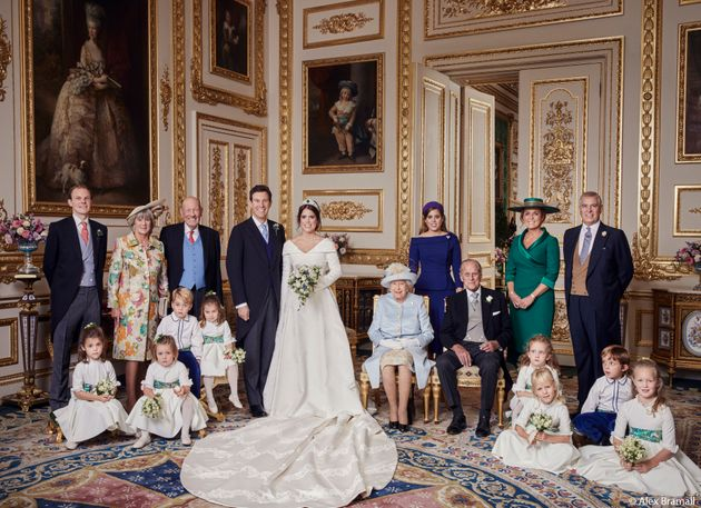 The newlyweds pose with (from left to right, back row):Thomas Brooksbank (Jack's brother); Nicola...
