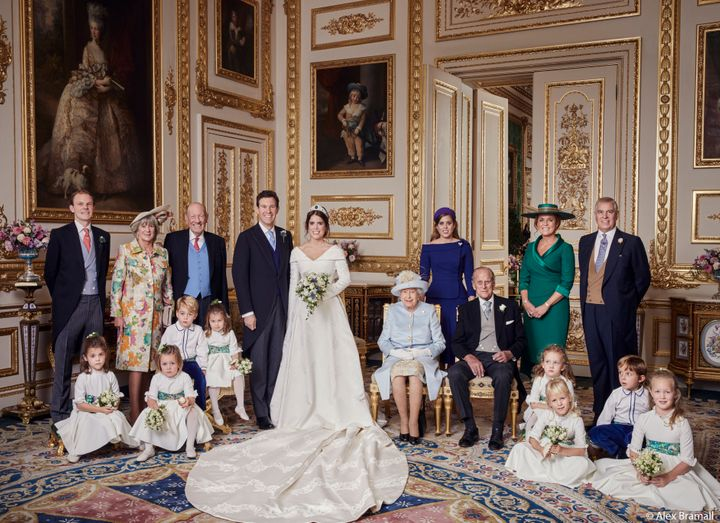 The newlyweds pose with (from left to right, back row): Thomas Brooksbank (Jack's brother); Nicola Brooksbank and George Brooksbank (his parents); Princess Beatrice; Sarah, Duchess of York; and her former husband, His Royal Highness The Duke of York. Middle row: Prince George, Princess Charlotte, Queen Elizabeth II and Prince Phillip, with the rest of the young pages and bridesmaids.
