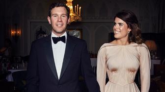 Princess Eugenie and Mr Brooksbank are pictured at Royal Lodge, Windsor ahead of the private evening dinner, following their Wedding.  Princess Eugenie's evening dress was designed by Zac Posen. Mr Posen was inspired by the beauty of Windsor and the surrounding countryside. The choice of colour reflects the blush of an English rose. Mr Posen took his inspiration from the White Rose of York.