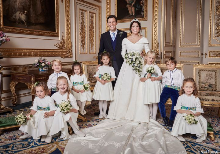 The newlyweds pose with their pages and bridesmaids. Prince George smiles in the back row with his sister, Princess Charlotte. Brooksbank rests his hand on the shoulder of Theodora Williams, daughter of singer Robbie Williams and Ayda Field.