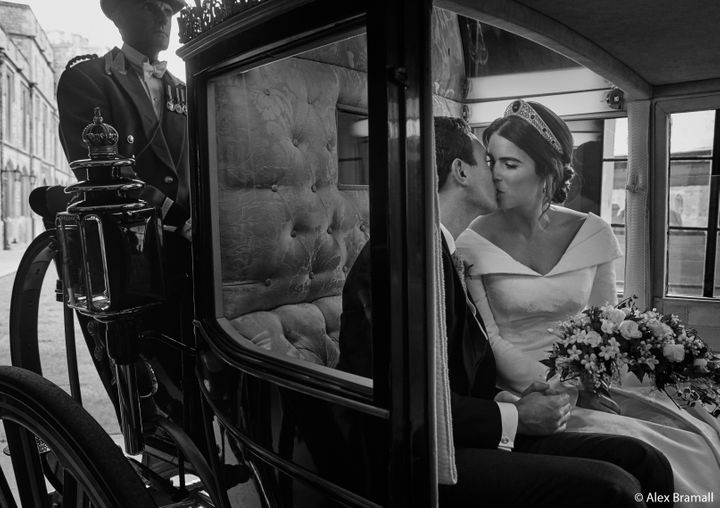 Princess Eugenie and Jack Brooksbank smooch in the Scottish State Coach as it returns to Windsor Castle following the Carriage Procession.