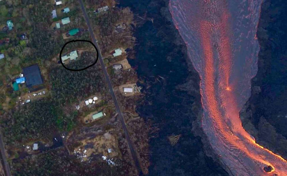 In this photo of fissure 8's river of lava, Janet Montrose's home is circled to show friends and family how close it was
