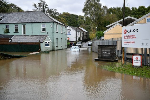 A car is stranded in floodwater in Tonna near Aberdulais, Neath, South