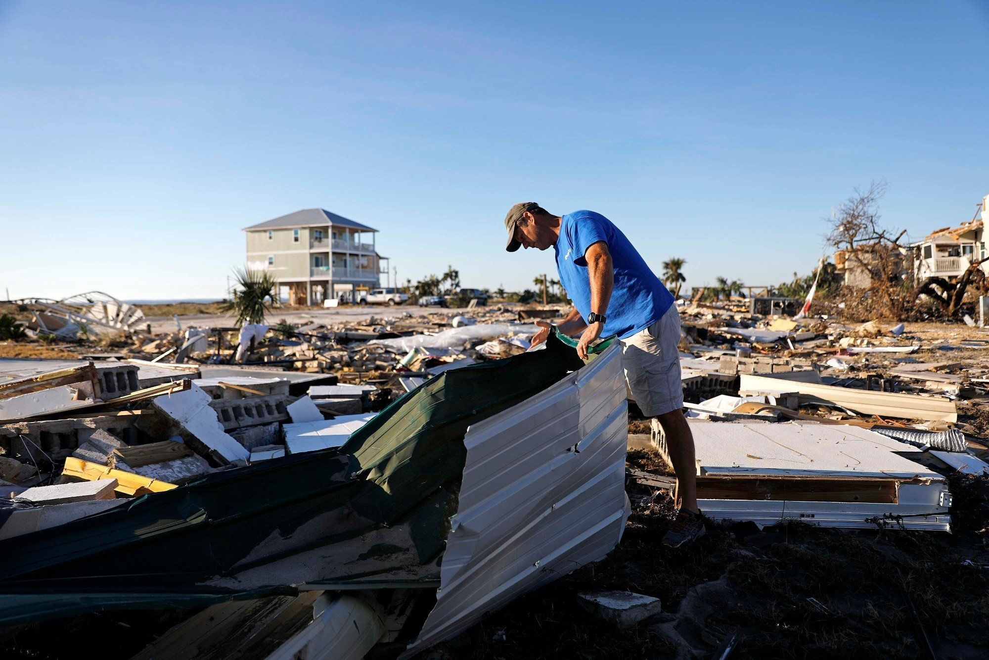 Mike Jackson sifts through debris looking for remnants of his home which was destroyed by hurricane Michael in Mexico Beach, Fla., Saturday, Oct. 13, 2018.
