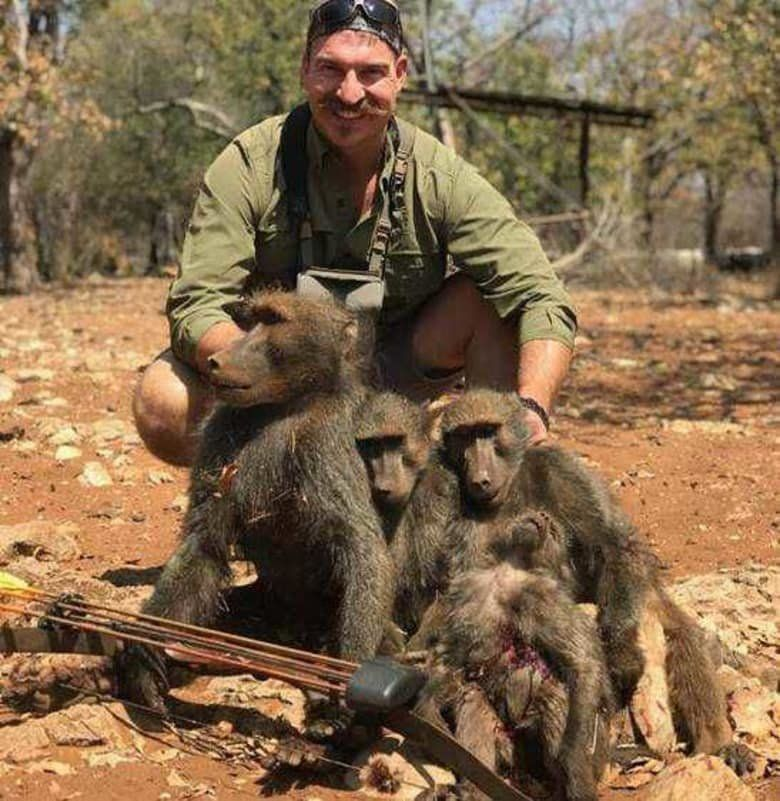 """Idaho Fish and Game Commissioner Blake Fischer poses with """"a whole family of baboons"""" that he said he shot in Africa."""