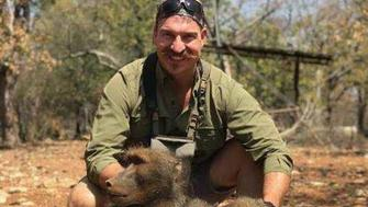 "Idaho Fish and Game Commissioner Blake Fischer poses with ""a whole family of baboons"" that he said he shot in Africa."