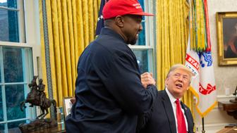 WASHINGTON, DC - OCTOBER 11: President Donald Trump and rapper Kanye West embrace in the Oval Office of the White House in Washington D.C. on October 11, 2018. (Photo by Calla Kessler/The Washington Post via Getty Images)