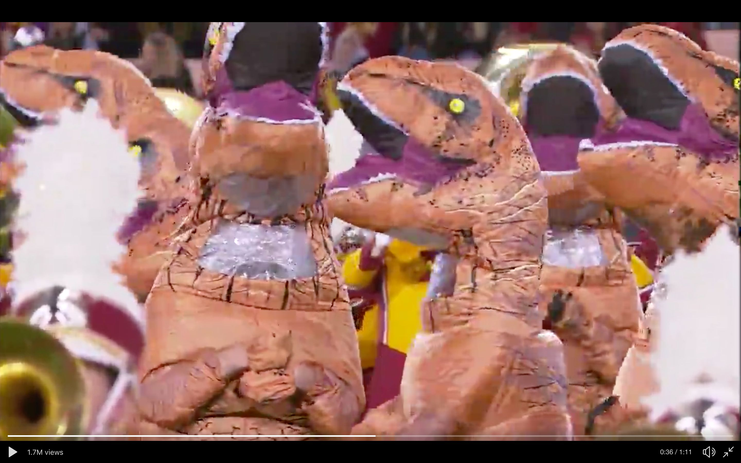 "Iowa State put dancing dinosaurs on the football field as the marching band played the theme from ""Jurassic Park."""